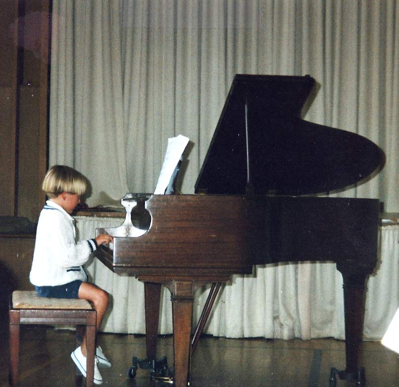 Robbie, age 5, at a piano recital