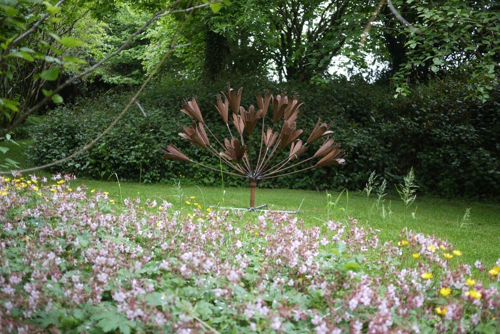 Agapanthas Sculpture on display at Stone Lane Gardens on the Edge of Dartmoor.  It is approximately 6ft in diameter and is designed to be either ground positioned as above, or high up on a stem.  Price - £1250