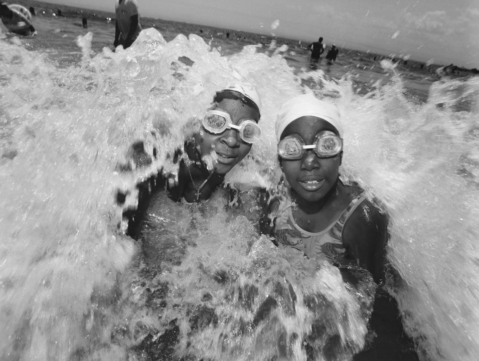 Girls with Goggles in the Surf, Coney Island, Brooklyn, New York,  2003 © Mary Ellen Mark