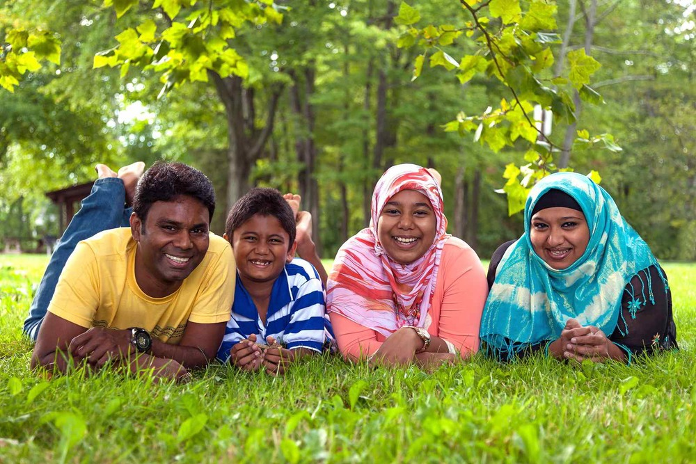 Muslim Family Lying on Grass.jpg