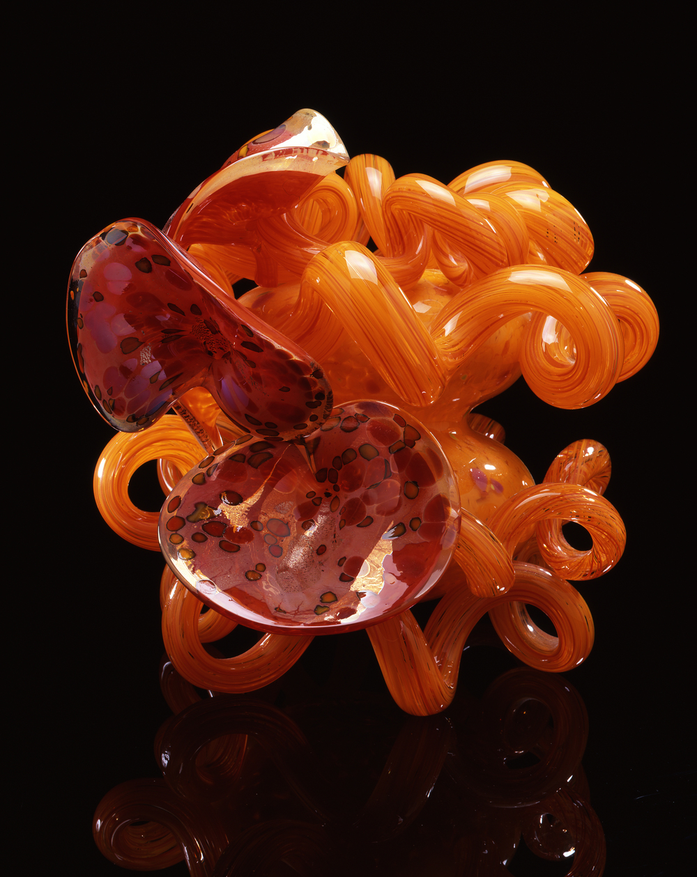 Dale Chihuly,  Cadmium Orange Coiled Venetian with Lilies  (1991, glass, 17 x 19 x 17 inches)