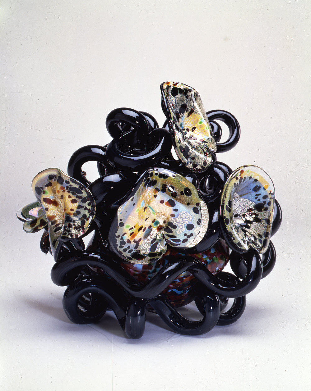 Dale Chihuly,  Black Coiled Venetian with Lilies  (1991, glass, 18 x 21 x 18 inches)