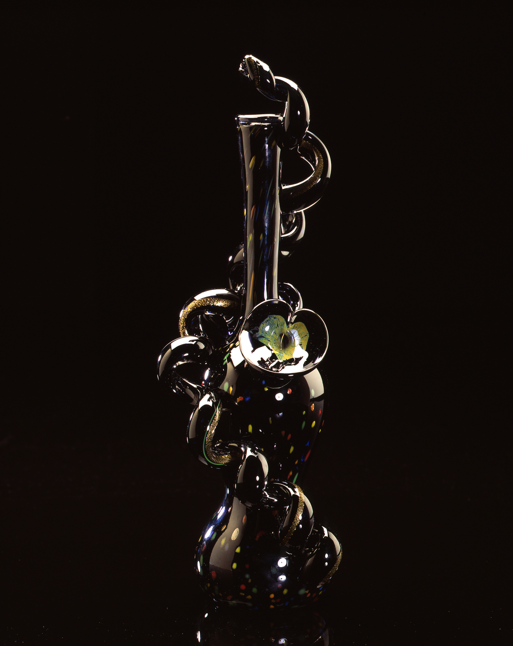 Dale Chihuly,  Spotted Black Onyx Piccolo Venetian with Lily and Coil  (1994, glass, 15 x 5 x 5 inches)