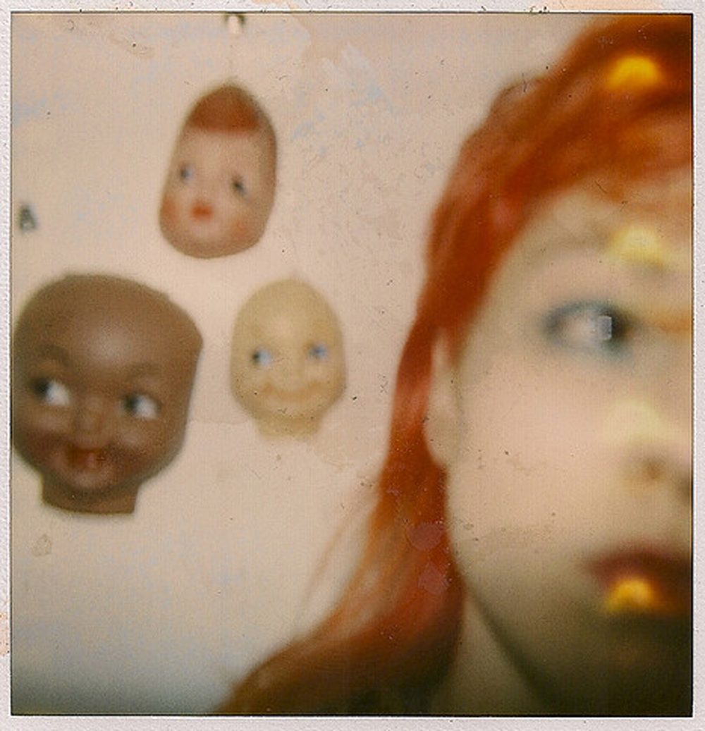 Nina With The Doll Heads
