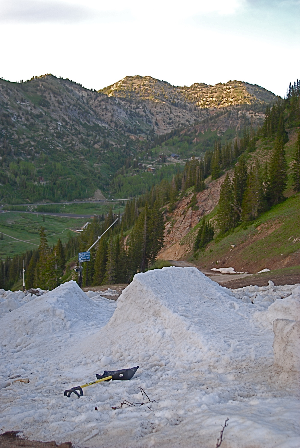 The union hiked up Alta mid June to see if there was anything to shred and stumbled across a spot where some snow had been cleared off an access road and piled into one area, with about two hours of work we dialed in this double came back the next day and had a few hours of fun.
