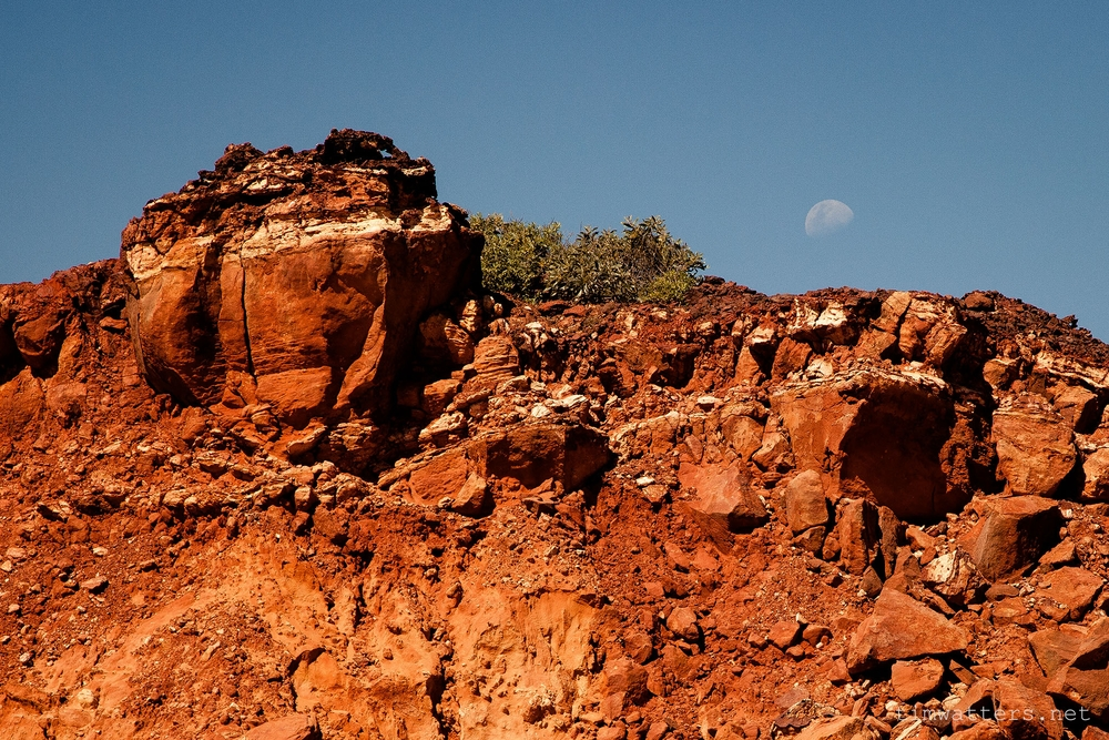 The moon sits above the cliffs of James Price Point.
