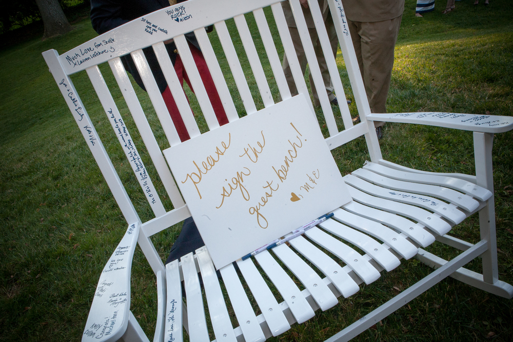 This 2013 couple had a love seat rocking chair for guest to sign.  Photo credit -  bridgetconley.zenfolio.com