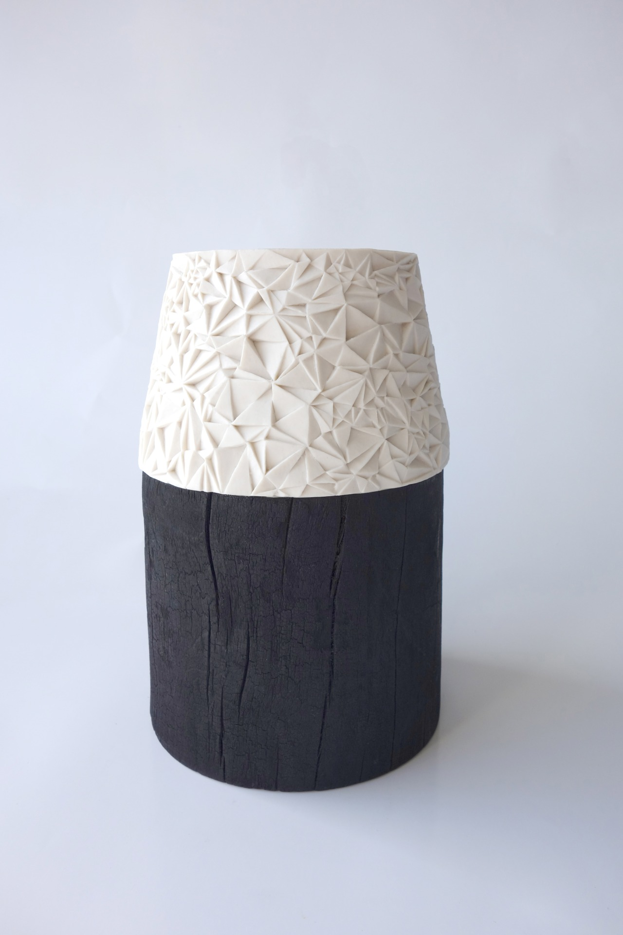 Hand carved porcelain, burnt beech  by Leah Jensen