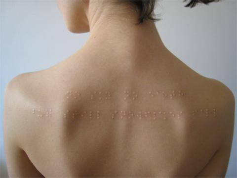 "Braille subdermal implants. Directly translates to, ""No sky no earth but still snowflakes fall"""