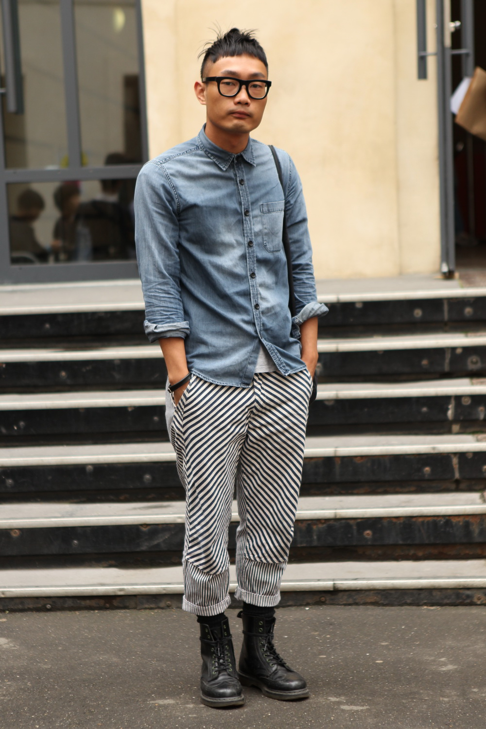 We spotted some super cool diagonal striped pants at #PFW today.   WGSN street shot