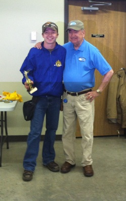 Jacob Goeden is shown accepting his third-place trophy with Minnesota Clay Target Founder Jim Sable.
