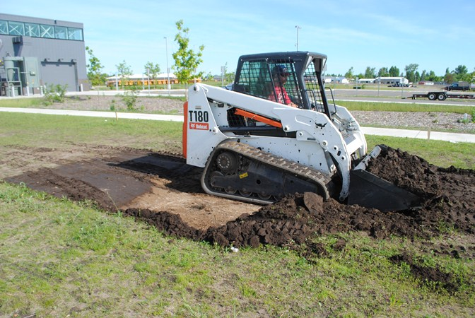 Nate Clefisch of Pete's Landscaping moves dirt on Monday, June 24 for Wadena-Deer Creek High School's new horticulture center to be located on the east side of the school campus. The foundation will be approximately 4 feet deep, with a layer of rock and mulch.