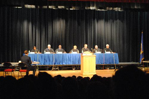 The Minnesota Supreme Court convened at Wadena Memorial Auditorium Wednesday to hear oral arguments of an actual case. Pictured from left: Justice Wilhelmina Wright, Justice Christopher Dietzen, Justice Alan C. Page, Chief Justice Lorie Gildea, Justice G. Barry Anderson, Justice David R. Stras, and Justice David L. Lillehaug. At the Appellant's table (at left) is attorney Roy Spurbeck.