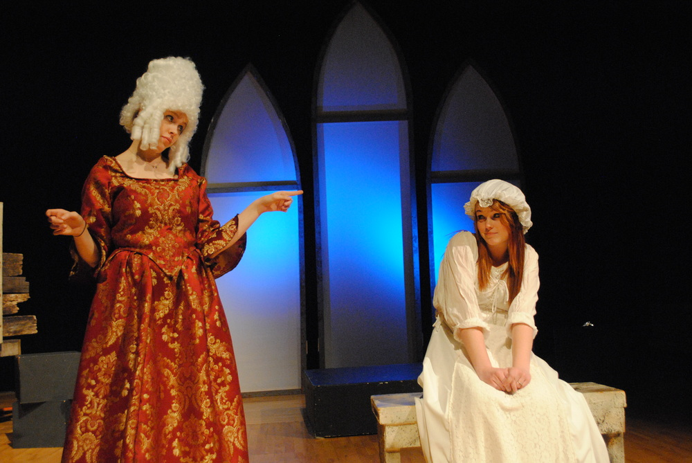 A teen-aged Marie Antoinette played by Samantha Kirkland (seated) gets some very needed counsel from her mother Maria Therese played by AJ Tollefson before she leaves for France.