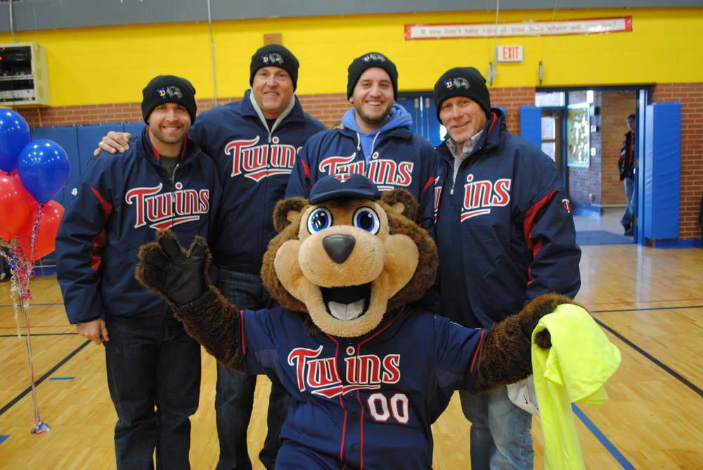 The Twins Caravan featured, from left, Brian Dozier, Tom Brunansky, Glen Perkins, Dan Gladden and TC Bear. They are pictured here sporting their Wadena-Deer Creek Wolverine stocking hats they received as thank you gifts. (Photos by Dana Pavek, WDC Schools)