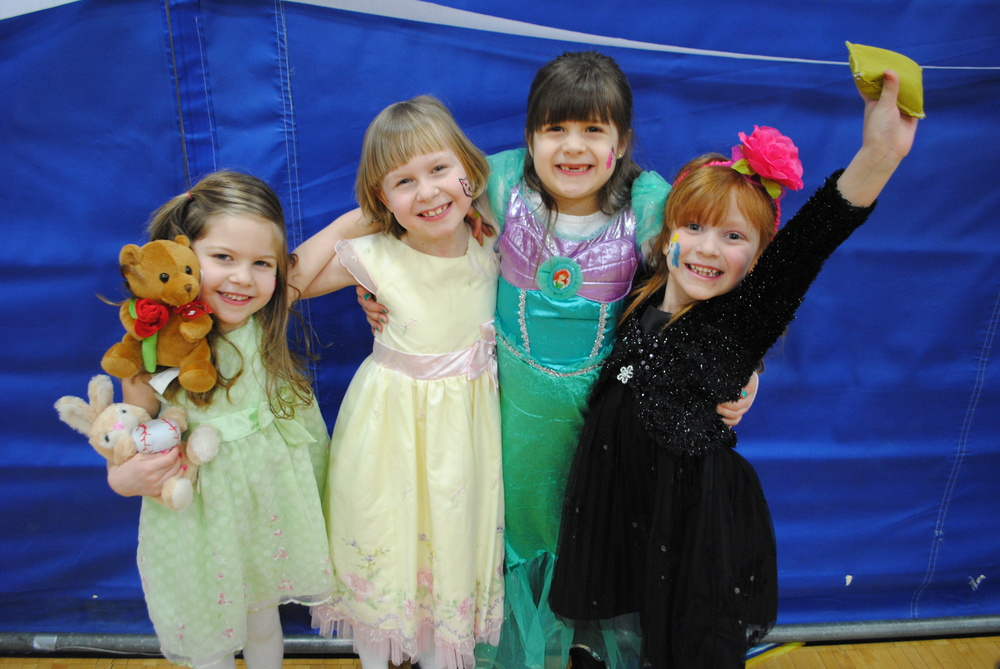 Sixty-five boys and girls dressed in their finest attire attended the Prince and Princess Party, Feb. 9, including these happy little princesses, from left: Lydia and Kelanie Oldakowski, Amara Neuerberg and Alexa Lind. (Photo by Dana Pavek, WDC Schools)
