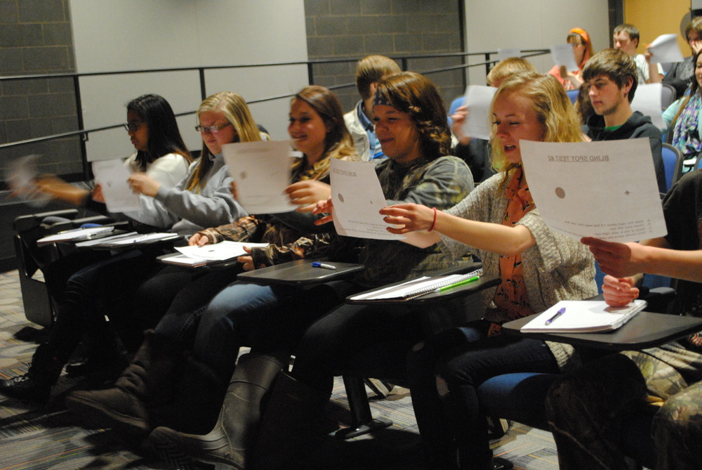 WDC students in Robby Grendahl's psychology class take part in a blind-spot test. The exercise was part of a presentation by Britta Knutson, University of Minnesota-Duluth med student on Tuesday.