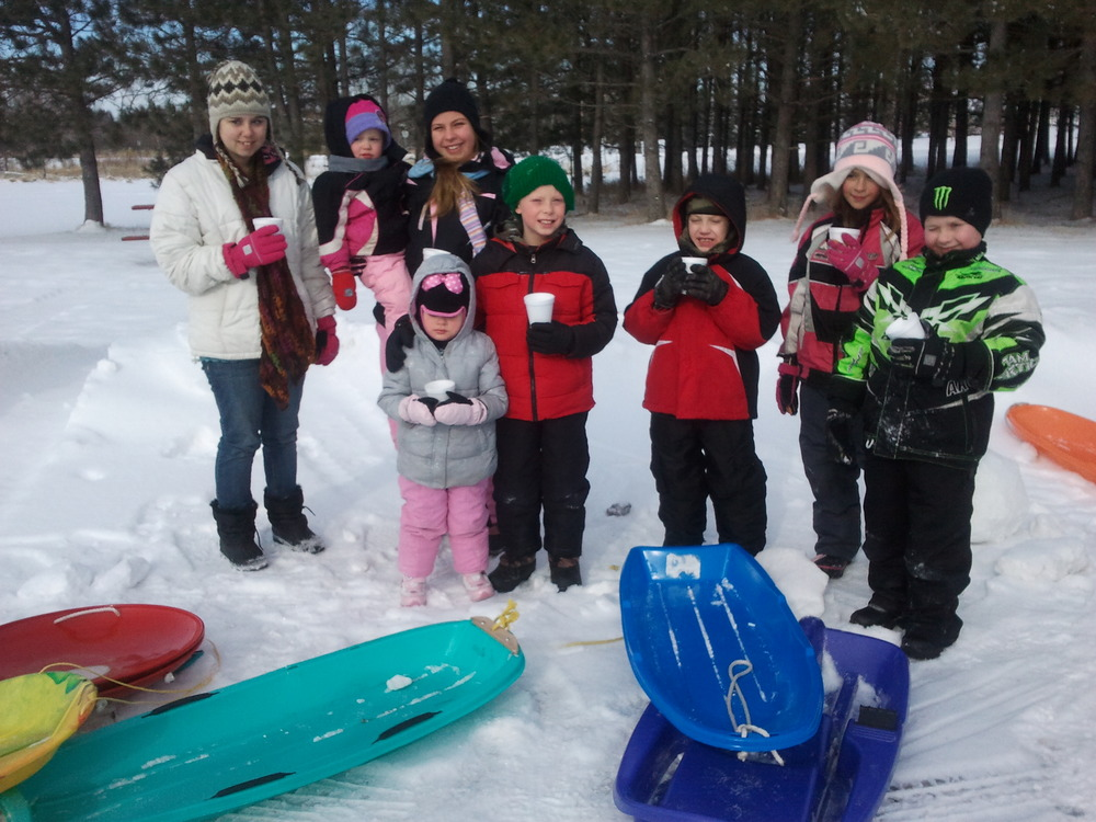 Last year's sledders taking a break to enjoy a cup of hot chocolate.