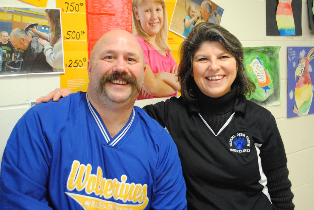 A clean-cut Dan Savoie with Vicki Smith, local coordinator of the Pennies for Patients cancer fundraiser. Both are teachers at WDC Elementary School.