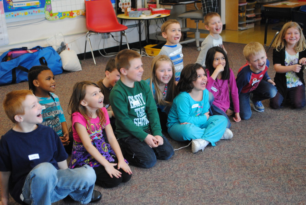 "These first graders respond with enthusiastic laughter after watching Perrin Boyd demonstrate the ""whack-a-noodle"" clowning exercise. The students are from Cheryl Kellen's class."