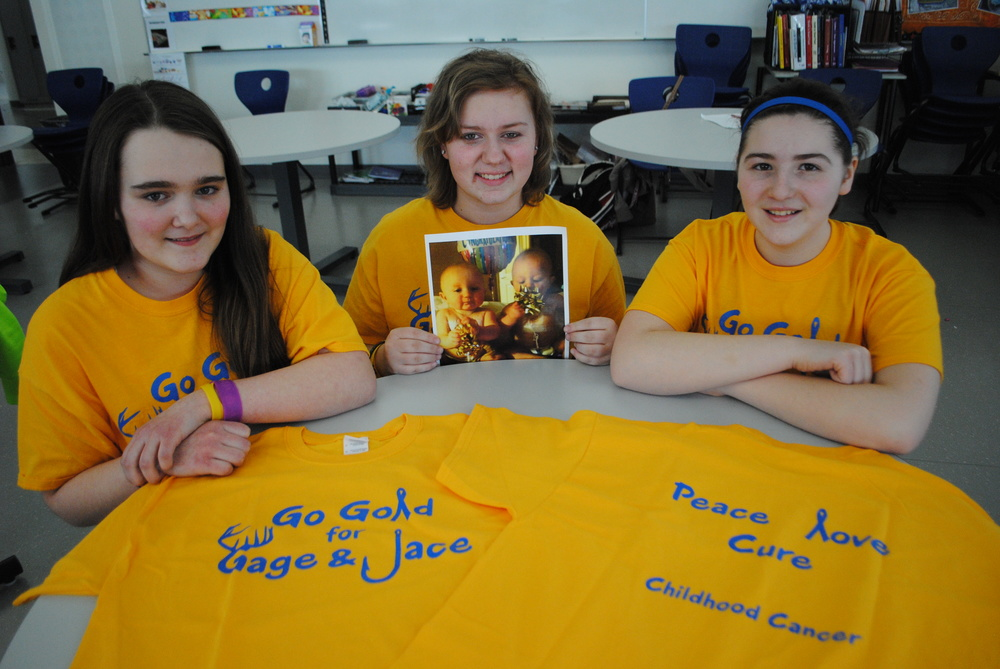 WDC eighth-graders Lyndsay Frisch, Hayley Maloney and Caitlin Savage are organizing a T-shirt fundraiser for identical twin infants, Gage and Jace Maloney, who've been diagnosed with cancer in August 2013. (Photo by Dana Pavek, WDC Schools)