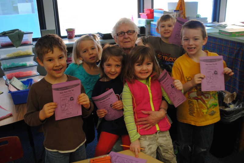 Alyssa Morlock's kindergarten students gather around Porter after they finish a reading exercise with her.