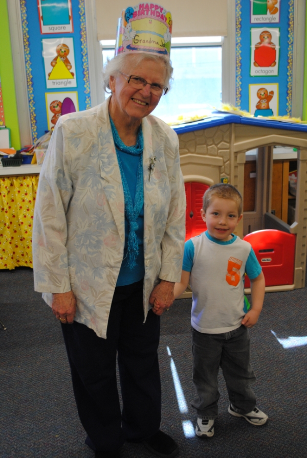 Preschooler Deken Gray leads Grandma Jo by the hand to their next classroom activity on Tuesday.