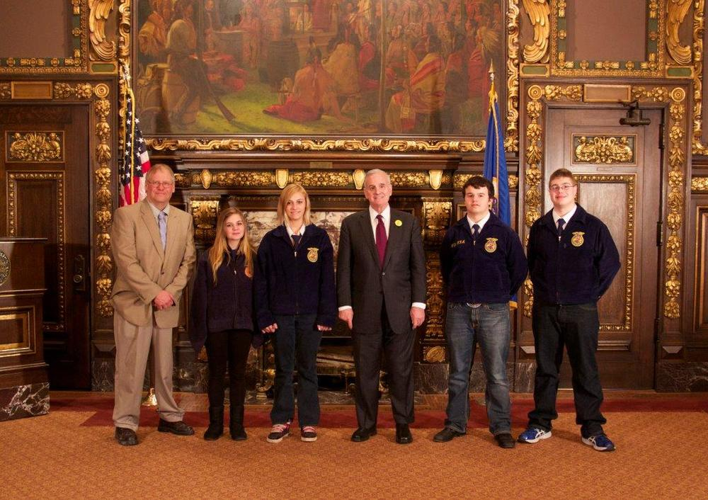 WDC FFA members had the opportunity to meet Gov. Mark Dayton recently in the Reception Room at the State Capitol in St. Paul. Gov. Dayton spent time visiting with and asking questions of the students. Pictured, from left: Richard Muckala, WDC FFA Advisor; Christa Jobe, Barb Zick, Gov. Dayton, Presley Sleyster and Ethan Benson. (Courtesy photo)