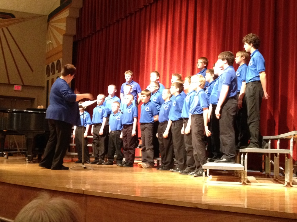 Mary Moen directs the Central Minnesota Boys Choir while they perform for WDC Elementary students Monday, April 14 at the Wadena Memorial Auditorium. (Photo by Louis Rutten, WDC Schools)