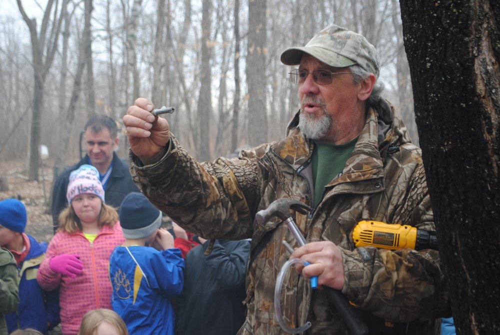 Schwartz shows students the different types of taps. He demonstrated how he drills a hole about 1 ½ inches into a maple tree and inserts the tap. After the season is finished, Schwartz takes out the tap and the tree hole heals itself close.