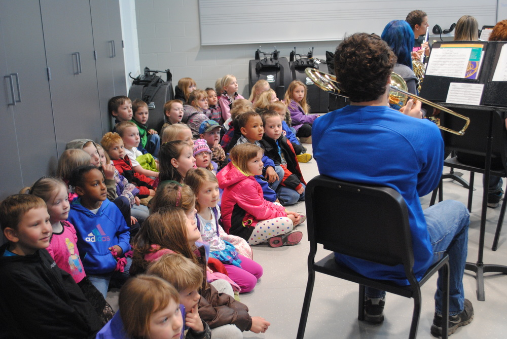 "Kindergarten students watch intently as the high school band performs a song from the movie, ""Frozen."" (Photos by Dana Pavek, WDC Schools)"