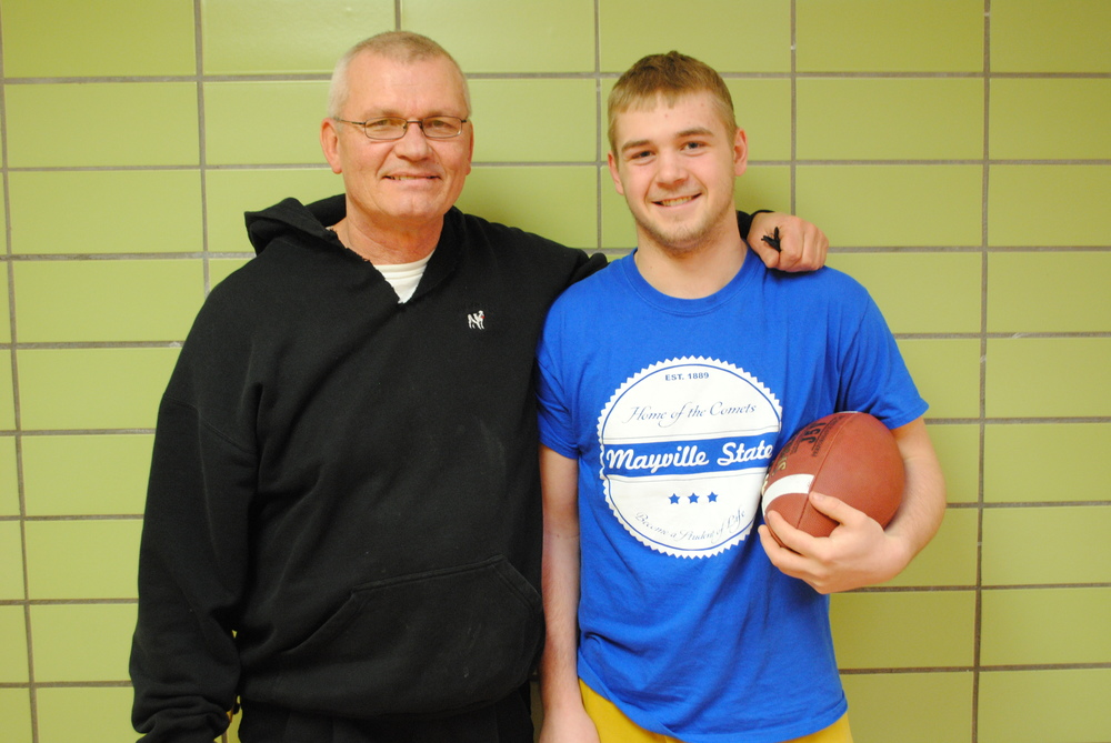WDC student-athlete Wyatt Weber signed a letter of intent to play football for Mayville State University. Pictured with Weber is his high school football coach, Howie Kangas.  (Photo by Dana Pavek, WDC Schools)