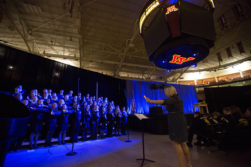 WDC Elementary music teacher Katy Westrom, right, directs the FFA State Choir during the state convention recently. For this song, the singers are using light sticks. (Courtesy photo)