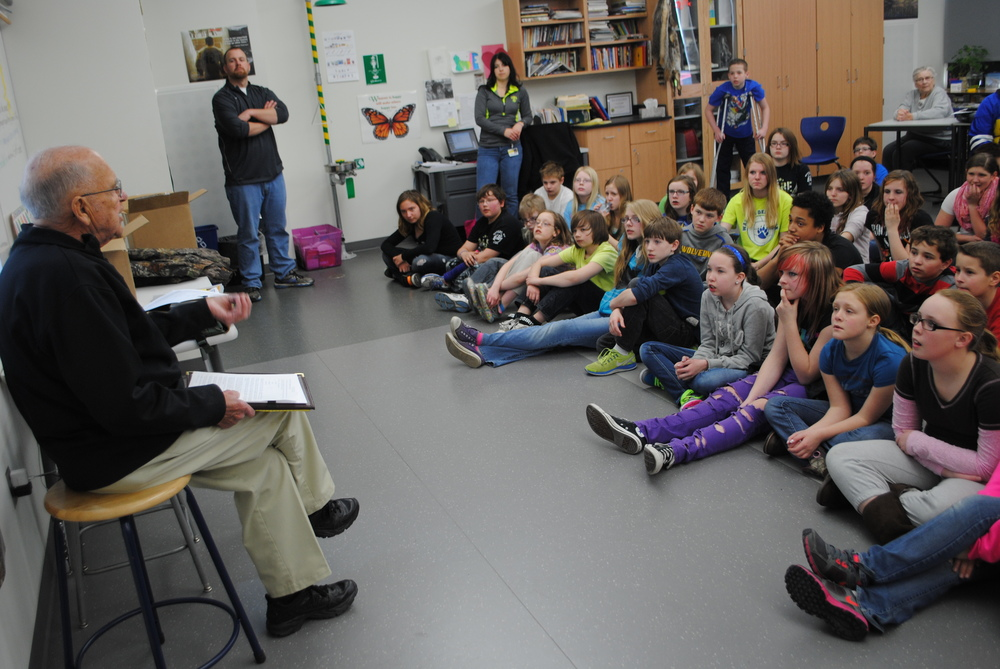 Wadena hunting enthusiast John Edinger talks with sixth-graders about how the Minnesota Deer Hunters Association educates young people on hunting and protecting the outdoors. Edinger serves as Region 4 director on the MDHA executive board.  (Photos by Dana Pavek, WDC Schools)