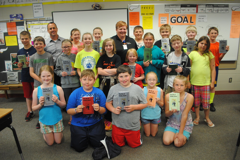 "Today, fourth-graders in Jeff Mehl's class got to hear the completed story of ""The Life of Bobby Quinn,"" which was started by their classmate Jane Fiemeyer, who lost her battle with Leukemia on Sept. 6, 2013. Each student received their own copy of the book as well, courtesy of Jil Fiemeyer. (Photos by Dana Pavek, WDC Schools)"