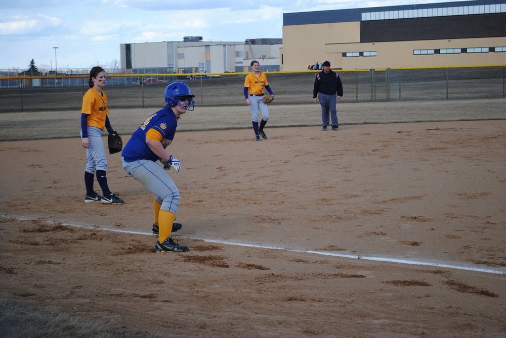 Senior Michaela Lehmkuhl has had a stellar career with the Wolverine softball team. She was known for her powerful batting (pictured above on third base) and broke a 19-year-old Wolverine home run record her sophomore year.