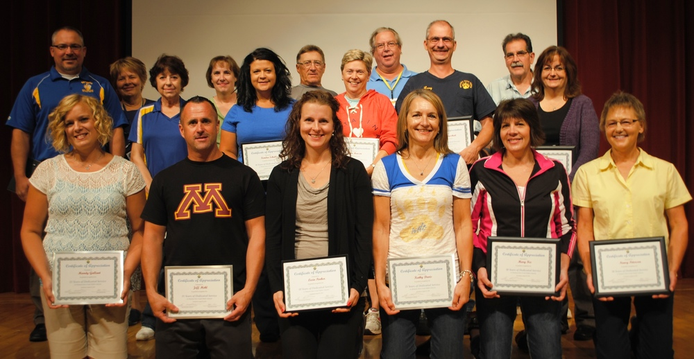 Those present to receive their years of service certificates at the recognition program on Aug. 26 included, front row, from left: Mandy Gallant, 15 years; Jeff Mehl, 15 years; Lecia Parker, 10 years; Kathie Davis, 25 years; Mary Fix, 30 years; and Nancy Peterson, 30 years; middle row, from left: Norm Gallant, 15 years; Bev Finnegan, 15 years; Kendra Schultz, 10 years; Pam Hanson, 20 years; Larry Wegscheid, 25 years; and Kathy Salo, 30 years; back row, from left: Mickey Lawson, 15 years; Lynn Quincer, 20 years; Dale Becker, 20 years; Tim Wohlert, 20 years; and Kevin LaBarre, 30 years. (Photo by Dana Pavek, WDC Schools)