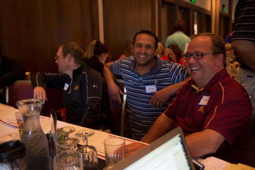 Educators Robby Grendahl, Scott Petrowski and Brian Maki had a chance to do some networking at the workshop. (Courtesy photo)