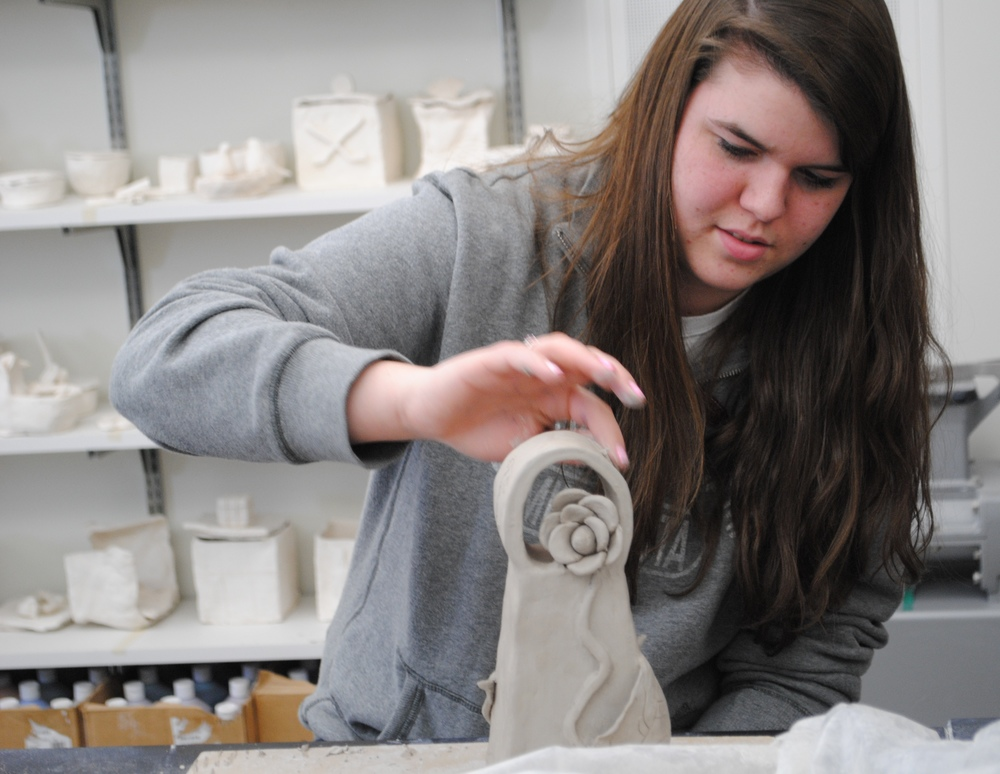 WDC student Jessica Wood works on sculpting her clay bell in a visual arts class taught by Laurie Kopischke-Pulju. Mrs. Kopischke-Pulju provides an exemplary arts education program which inspires student artists to delve into a variety of media. (Photos by Dana Pavek, WDC Schools)