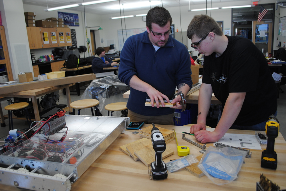 The WDC Robotics program is in its fourth year at WDC Schools and continues to be a strong and popular program for WDC high school students. Pictured above is coach Shane Snyder helping Ethan Benson solve an engineering issue during the building of the robot last school year. Mike Shrode also serves as a Robotics coach.