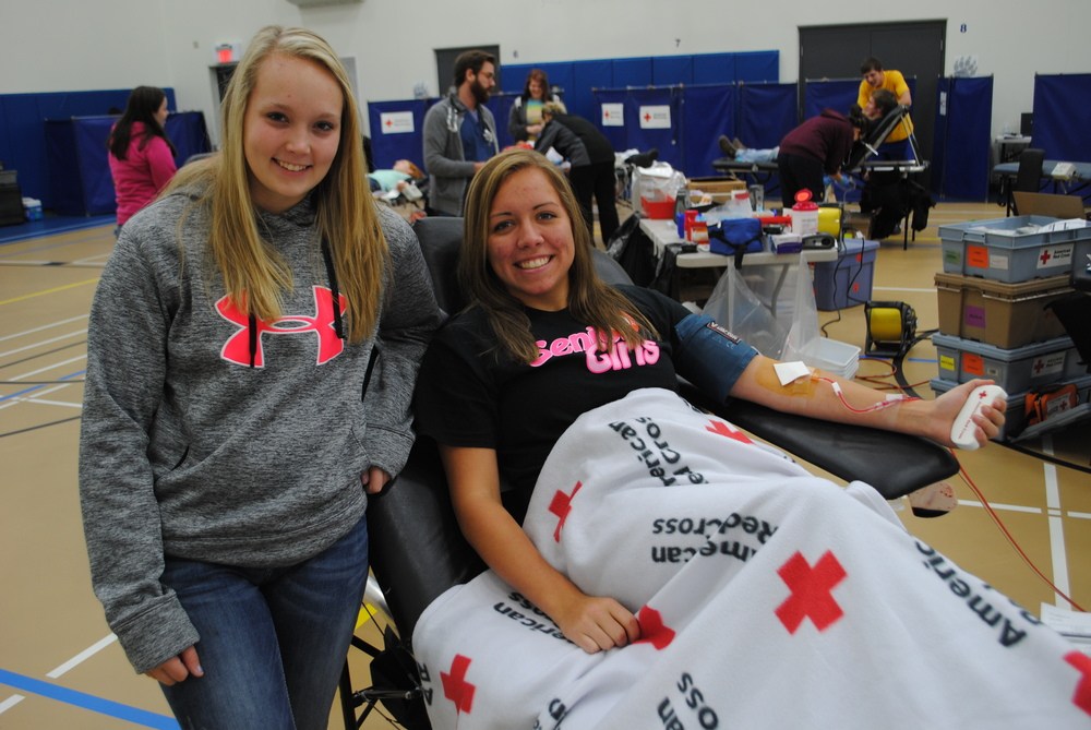 "WDC NHS student Mikena Formanek, left, serves as a ""blood buddy"" to Maddy Hinojos during the NHS blood drive Oct. 22 at WDC Middle/High School. (Photos by Dana Pavek, WDC Schools)"