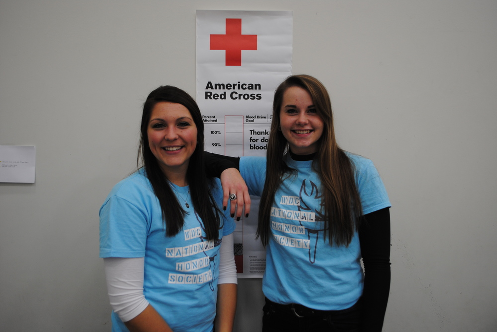 Senior NHS students Morgan Zeise, left, and Jennifer Craig organized the blood drive as their community-service project.