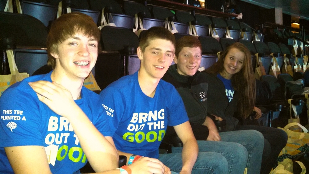Waiting for the We Day rally to begin this morning are WDC students, from left, Jarrett Pettit, Austin Sutherland, Ryan Olson and Lauren Soroko. (Photo by Rachel Bounds.)