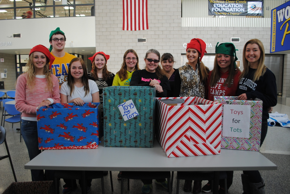 Preparing for the Toys for Tots Drive are BPA members, from left: Marissa Jahnke, Matthew Quincer, Kylie Lupkes, Jessica Langer, Ashley Peters, Elise Kallevig, Tabetha Baker, Danyel Post, Maddy Hinojos and Carrie Nelson. Not pictured: Anna Kraemer. (Photo by Dana Pavek, WDC Schools)