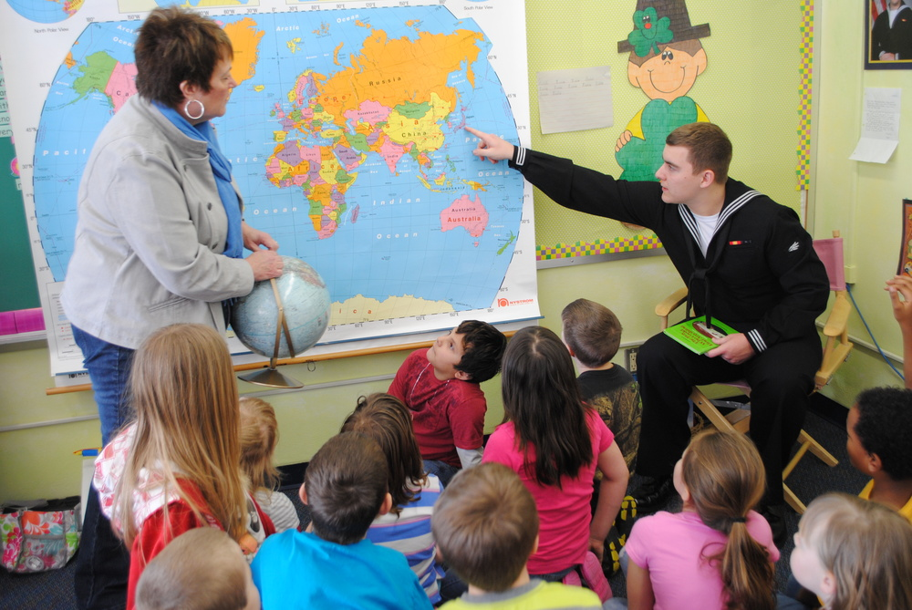 Last year, Eliah Anderson surprised Junelle Jackson's second-grade students by visiting the class and being a guest reader. The class had been corresponding with him while he was receiving his training in the states. In this picture, Andersonpoints to the naval base in Japan, where he is now stationed. The 2012 Wadena-Deer Creek graduate is serving in the U.S. Navy. (Photo by Dana Pavek, WDC Schools)
