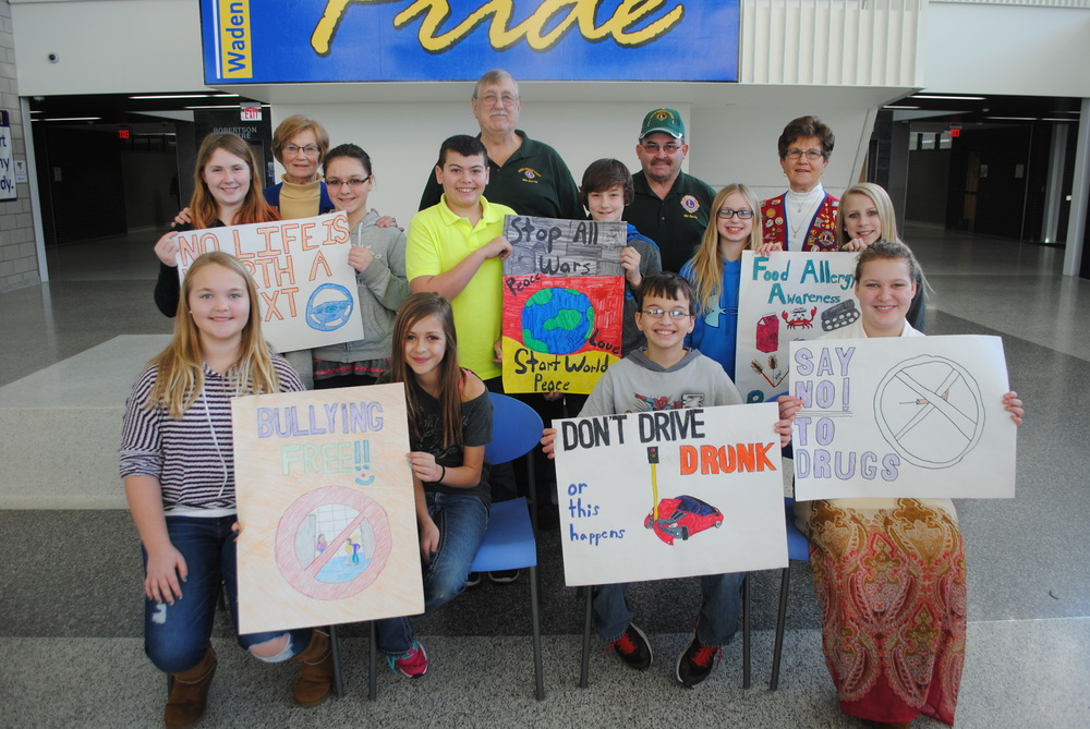 The Bluffton, Deer Creek and Wadena Lions clubs recently awarded the winners of their annual poster contest. Pictured, back row, from left: Wadena Lions poster winners Kylie Matthews and Joslynn Judd with Nellie Wegscheid, Wadena Lions representative; Deer Creek Lions poster winners Zach Shaw and Kade Woods with Larry Spenst and Lance Wohlwend, Deer Creek Lions representatives; and Wadena Lions poster winners Emma Mehl and Teagan Roberts with Marge Harrison, Bluffton Lions rep and Poster Contest coordinator; front row, from left: Nevada Schulz and Allyson Swenson, fourth place; Ben Albright, fifth place; and Katelyn Gardner, sixth place. (Photo by Dana Pavek, WDC Schools)