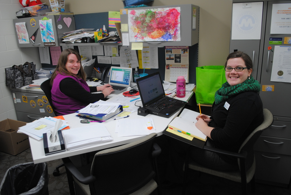 Wadena-Deer Creek Middle/High School licensed counselor Toni Kraska, left, and intern Katie Edin, right, see a steady stream of students throughout the school day at WDC.