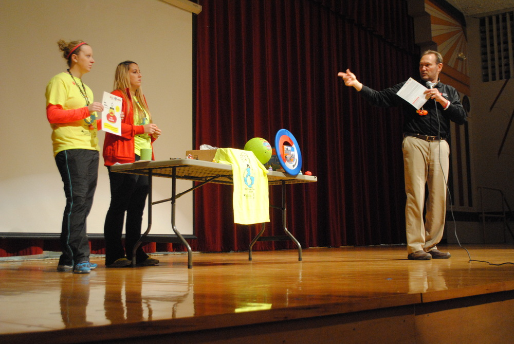"Wayne Geary explains to students what it takes to be a heart hero for the ""Jump Rope for Heart"" fundraiser on Wednesday, Feb. 4. Helping with the presentation were WDC Physical Education teachers Katie Hill, left, and Danielle Jetvig-Renner. (Photo by Dana Pavek, WDC Schools)"