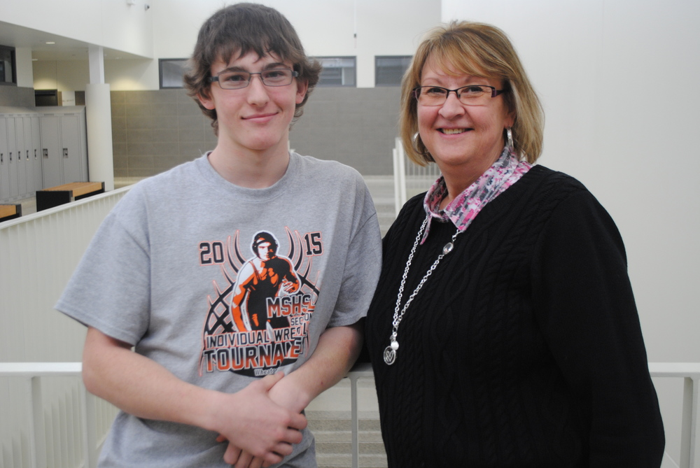 A very proud Deb Wright (WDC Middle/High School paraprofessional) is pictured here with her grandson, Carter Wright, who advanced to the State Wrestling Tournament after having an incredible Section wrestling tourney last week. Carter will have a huge fan club of family members at the tourney on Friday and Saturday to cheer him on in St. Paul. Photo by Dana Pavek, WDC Schools