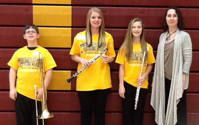Grades 6-8 Yellow Band featured WDC students, from left: Sean Carlson, Kamea Schreves, Mackenzie Carsten and Dr. Amy Roisum-Foley, Director of Bands from Mankato State University. (Photo courtesy of MBDA)